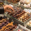 Buying chocolate truffles — Stock Photo