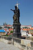 Statue on famous Charles Bridge (Prague) — Stok fotoğraf