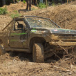 Recovering the vehicle from the muddy terrain — Stock Photo