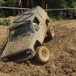Off road car stuck in a muddy terrain — Stock Photo