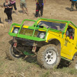 Yellow off-road car on a steep slope — Stock Photo