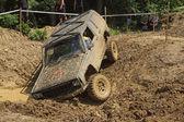 Off road car stuck in a muddy terrain — Stock Photo
