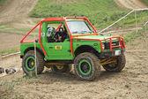 Green off road car in the tarrain — Stock Photo