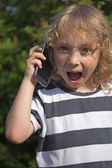 Surprised calling blond boy — Stock Photo