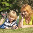 Stock Photo: Mother and her son are calling outdoors