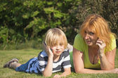 Mother and blond boy calling. — Stock Photo