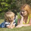 Mother and son are calling outdoors. — Stock Photo