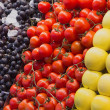 Apples, Tomatoes and grapes at the market — Stock Photo