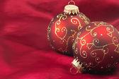 Two red christmas bulbs — Stock Photo