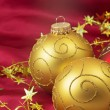 Two golden and one red christmas bulbs — Stock Photo