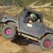 Offroad car is overcoming a difficult terrain — Stock Photo