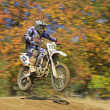 Stock Photo: Racer in blue and white is jumping