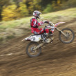 Motocross rider is going uphill. Dynamic shot. — Stock Photo