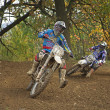 Couple of motocross racers in turn — Stock Photo #33726503