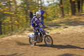 Racer in blue is riding motorcycle — Stock Photo