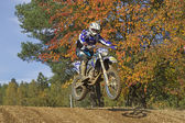 Motocross racer is jumping — Stock Photo