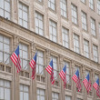Old building with American flags — Stock Photo