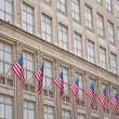 Old building with American flags — Stock Photo #35508929