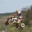 Постер, плакат: Dynamic shot of Quad racer jumping