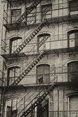 Old building with outdoor staircase — Stock Photo
