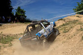 Off-road car is hitting a steep hill — ストック写真