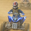 Young Quad motorbike racer in blue — Stock Photo #9419115