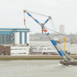 Tug-boat dragging a crane - Stock Photo