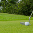 Golf ball on front of a driver — Stock Photo #12499922