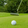Golf ball on front of a driver — Stock Photo #12499930