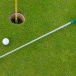 Golf hole with ball and putt — Stock Photo