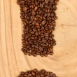 Exclamation mark from coffee beans — Stock Photo
