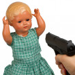 Very old baby doll (1940s) with handgun — Stock fotografie