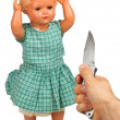 Very old baby doll (1940s) with knife — Stock Photo #12502474