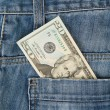 Macro shot of trendy jeans with american 20 dollar bill — Stock Photo