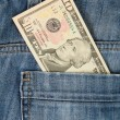 Macro shot of trendy jeans with american 10 dollar bill — Stock Photo