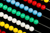 Close-up of an abacus on a black background — Stock Photo