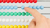 A man using an abacus on a white background — Stock Photo