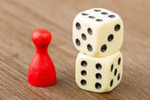 One red pawn and two dice — Stock Photo