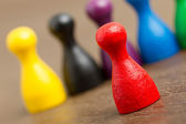 Six colored pawns isolated — Stock Photo