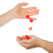 Five red dice being thrown from a hand — Stock Photo