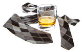 Glass of whisky and a tie — Stock Photo