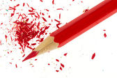 Red pencil and wood shavings — Foto de Stock