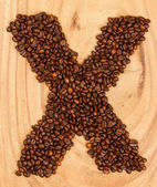 Letter X, alphabet from coffee beans — Stock Photo