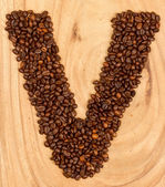 Letter V, alphabet from coffee beans — Stock Photo