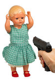 Very old baby doll (1940s) with handgun — Stock Photo
