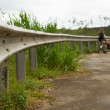 Stock Photo: Grey guardrail on rural roadside with nice perspective