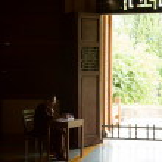 DA NANG, VIETNAM - JULY 28: Buddhist monk writing in a book in t — Stock Photo #14005479