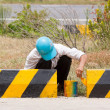 Mpainting roadworks barriers on road in Vietnam — Stock Photo #14005588