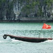 Stock Photo: Rowing boat in HLong Bay