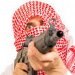 Arab adult with machine gun, terrorist — Stock Photo #14006265